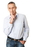 Man with silent gesture Stock Photos