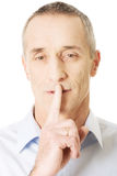 Man with silent gesture Stock Photo