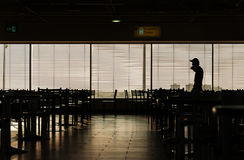 Man silhouette in airport cafe Royalty Free Stock Image