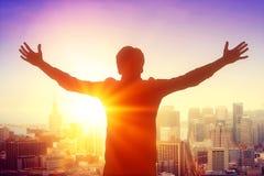 Man silhouette celebrating success Stock Photos
