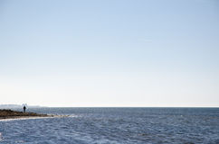Man silhouette by the coast Stock Photos