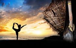 Man silhouette doing yoga Stock Photos