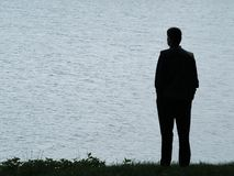 Man silhouette at evening. Man silhouette at lakeside Royalty Free Stock Images