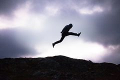 The Man Silhouette in the Jump Stock Photography