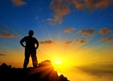 Man silhouette on a marine cape at the sunset Stock Photography