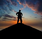 Man silhouette on a mountain top Stock Photography