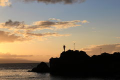 Man Silhouette. A peaceful silhouette of a man looking at the ocean stock photo