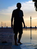 Man Silhouette by Pool. Near beach before twilight royalty free stock photos