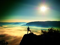 Man silhouette on the sharp peak. Satisfy hiker enjoy view. Stock Images