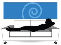 Man silhouette on sofa Stock Image
