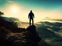Man silhouette stay on sharp rock peak. Satisfy hiker enjoy view. Royalty Free Stock Photo