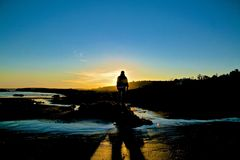 Man silhouette sunset beach Stock Photos