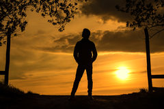 Man silhouette the sunset. Dark toned photo Stock Images