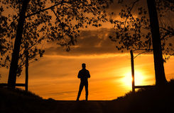 Man silhouette the sunset. Dark toned photo Stock Photography