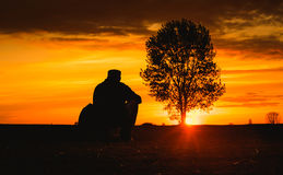 Man silhouette the sunset in nature. Dark toned photo Royalty Free Stock Photography