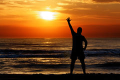 Man silhouette waving sun sunset sea Royalty Free Stock Photos