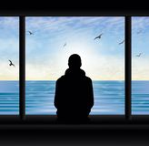 Man thinking silhouette at the window looking at lake stock photos