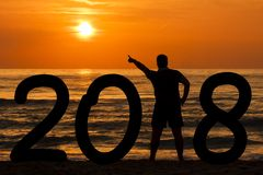 Man Silhouette year 2018 at sunrise at sea stock image