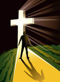 Man silhouetted in bright cross Stock Photo