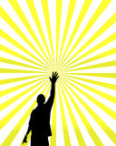 Man silhouetted on sunburst. An illustration of a man with a raised arm, silhouetted on the bright yellow rays of a sunburst Stock Photography