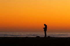Man silhouetted at sunset Royalty Free Stock Photography