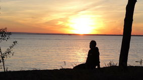Man silhouettes at sunset a clear summer night stock video footage