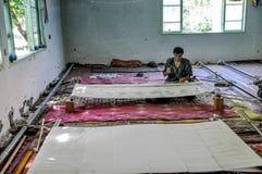 Man in silk factory in Uzbekistan Royalty Free Stock Photos