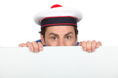 Man in a silly sailor's hat Stock Photography