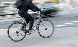 Man on silver colored bike Stock Photos