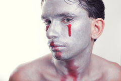 Man with silver makeup and blood on face Royalty Free Stock Photography