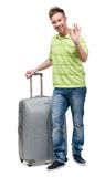Man with silver suitcase gesturing OK Royalty Free Stock Photo