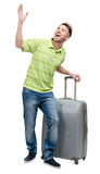 Man with silver suitcase pointing up with hand Stock Photography