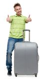 Man with silver suitcase thumbs up Royalty Free Stock Image