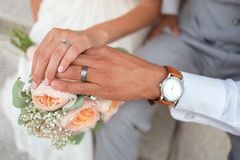 Man in Silver Wedding Ring Touching Peach Roses Royalty Free Stock Photos