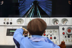 Man on simulator control panel Stock Image