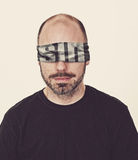 Man with sin blindfold. Royalty Free Stock Image