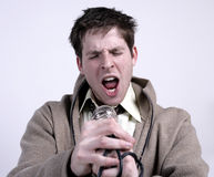 Man singing. Into a mic stock photography