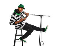 Man Singing. African American man singing into vintage microphone isolated over white background Stock Photography