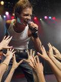 Man Singing Close To Adoring Fans Stock Photography