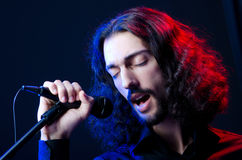 Man singing at the concert. Man singing song at the concert Stock Images