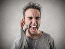 Man singing with earphones royalty free stock photo