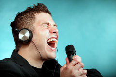Man Singing Into Microphone Happy Karaoke Signer Royalty Free Stock Photography