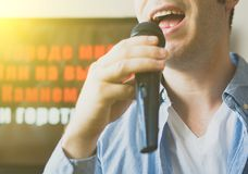 Man singing karaoke. Man singing karaoke at home. Close-up view Stock Photos