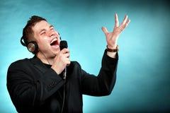 Man singing into microphone happy karaoke signer Royalty Free Stock Photo