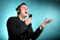 Man singing into microphone happy karaoke signer Stock Images