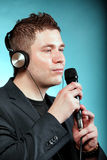 Man singing into microphone happy karaoke signer Royalty Free Stock Photo