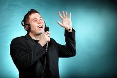 Man singing into microphone happy karaoke signer Stock Image