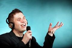 Man singing into microphone happy karaoke signer Royalty Free Stock Images