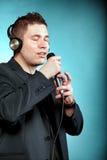 Man singing into microphone karaoke signer Royalty Free Stock Image