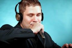 Man singing into microphone karaoke signer Royalty Free Stock Photos
